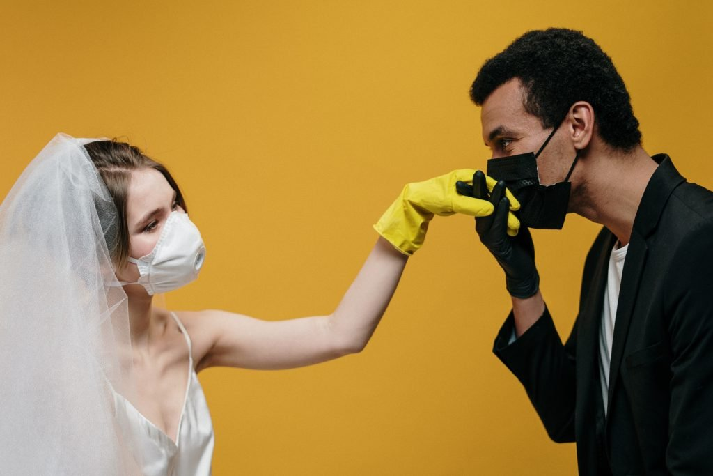 Covid bride and groom wearing masks