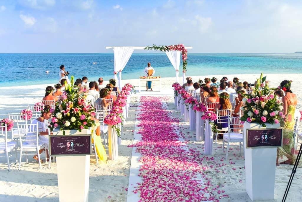 Wedding guests at beach wedding.