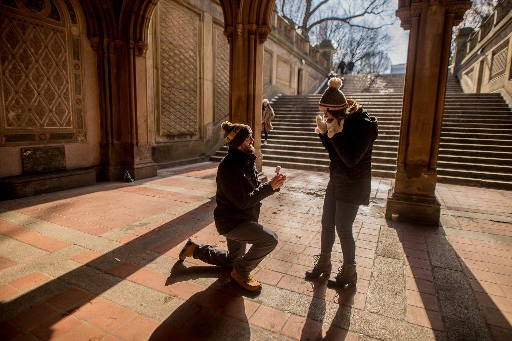 Man on one knee proposing