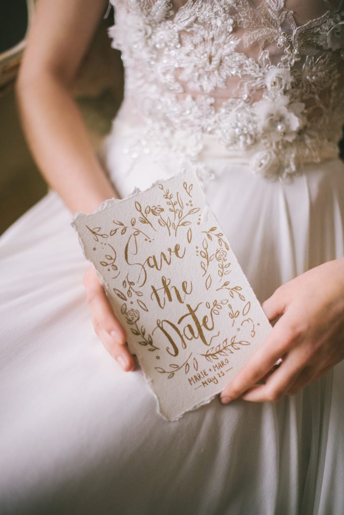 Bride holding Save the Date card