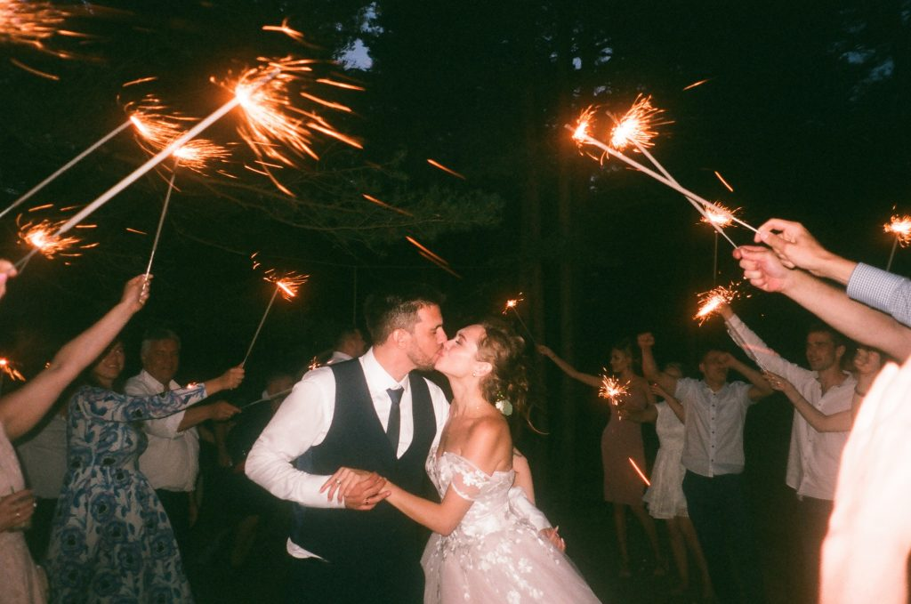 Wedding couple with guest sparklers
