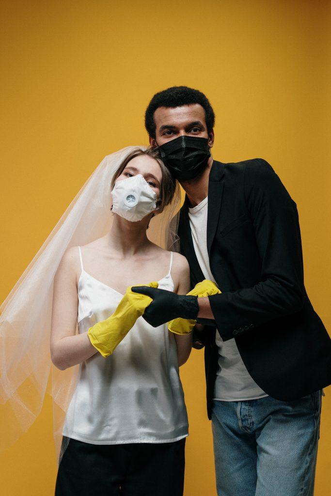 Wedding couple wearing masks