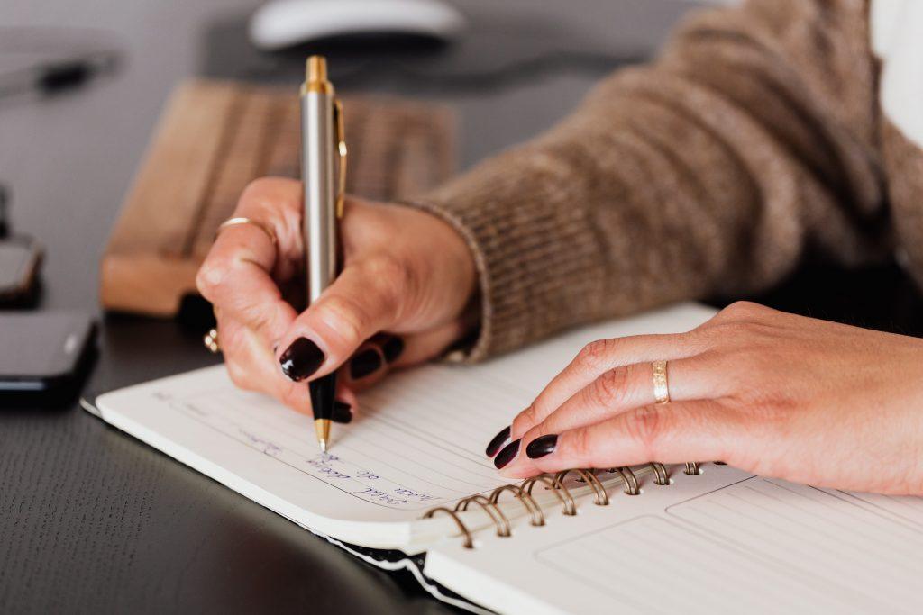 Wedding planner writing in journal